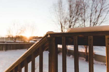 Snowy winter landscape as seen from the back porch of a modern home. Stock Photo
