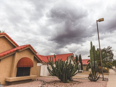 Dark storm clouds over homes in a subdivision in Scottsdale, Arizona, USA.