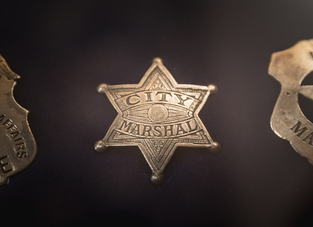 Vintage police badge with the words City Marshal on it. Stock Photo