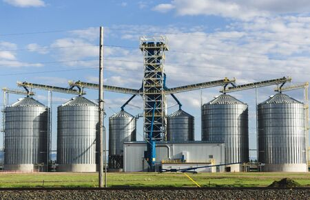 Metal grain silos on a large farm in central Montana, USA.