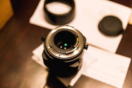 Camera lens with bottom glass and mount facing upwards. Stock Photo
