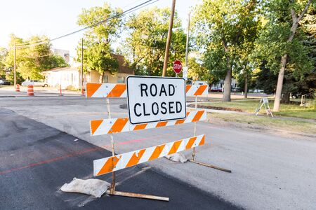 Residential street blocked by Road Closed construction sign. Stock Photo