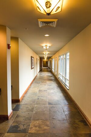 Empty hallway in an upscale hotel building.