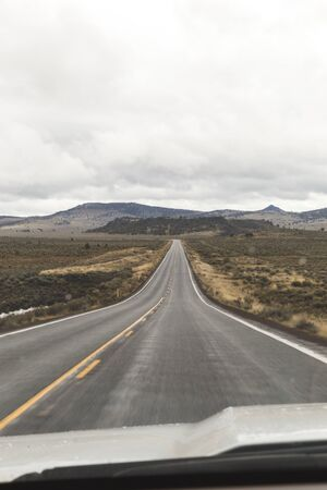 Driver point-of-view on rural, high-desert highway. Oregon, USA. Stock Photo