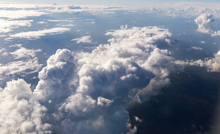 Puffy clouds seen from an airplane.