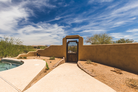 Stucco architecture in the back yard of a desert home in Arizona, USA.