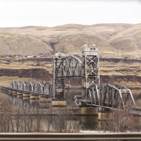 Steel draw bridge over the Columbia River in the Columbia River Gorge area of Oregon, USA.