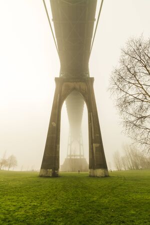 St. Johns Bridge surrounded by fog on a winter day in Portland, Oregon, USA.