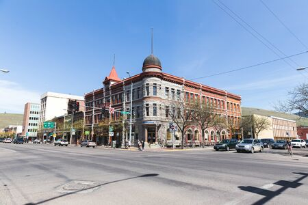 Buildings and traffic on a corner in downtown Missoula, Montana, USA. Editorial