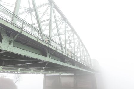 Steel or metal bridge in thick fog.