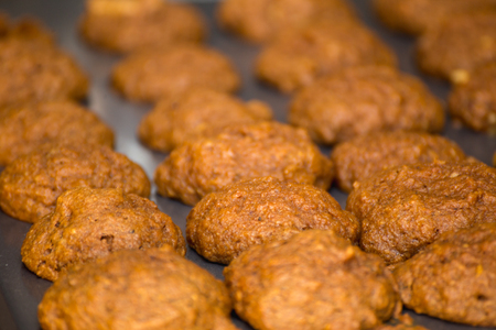 Baked health food cookies on a cooking sheet. Cookies without processed ingredients.
