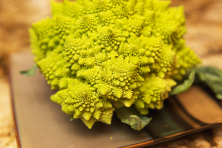 Bright green and yellow Romanesco broccoli on a plate. Banco de Imagens