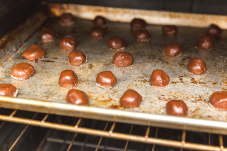 Raw chocolate cake balls in the oven, about to be baked.