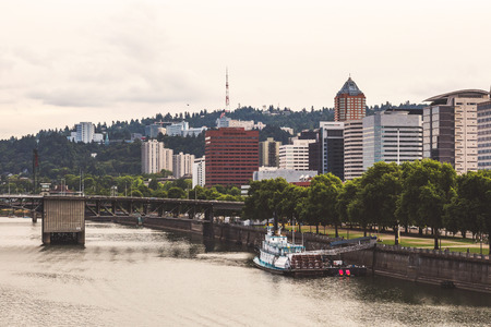 A river boat is anchored alongside the waterfront in downtown Portland, Oregon, USA.