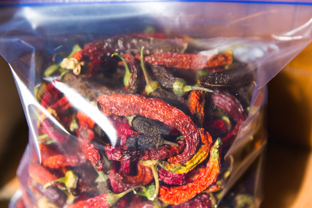 Dried or dehydrated hot peppers stored in a plastic bag. Banco de Imagens