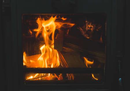 Flames of wood burning inside wood stove. Zdjęcie Seryjne