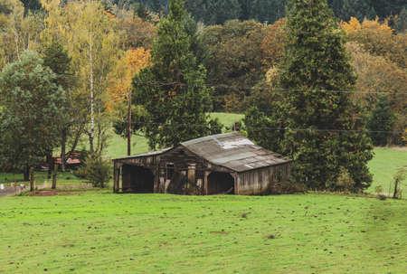 Decrepit old or abandoned building in rural farmland. Old building in farm or vineyard. Zdjęcie Seryjne
