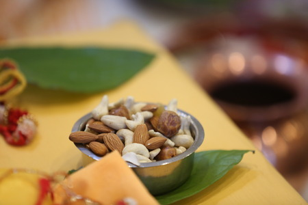 pooja: Selection of nuts for Hindu pooja ceremony Stock Photo