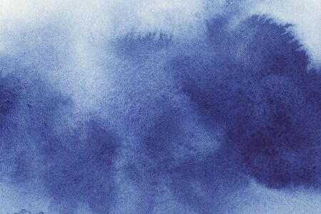 Navi, classic blue, indigo watercolor texture background with wet brush stains, strokes. Watercolor wash. Abstract artistic frame, empty space for text. Acrylic hand painted gradient backdrop. 版權商用圖片