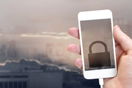 Global security concept. Lock icon on iphone screen 스톡 콘텐츠 - 114746384