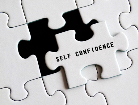 Self - Confidence text on missing puzzle. 写真素材