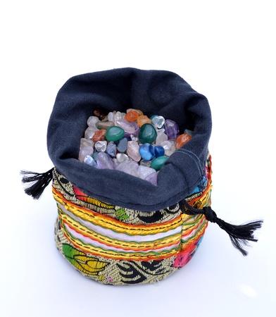 Sack of semiprecious pebbles and multicoloured quartz beads photo