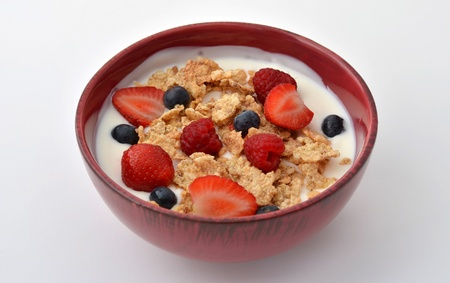 grain and cereal products: Breakfast bowl with yogurt, cereal, strawberries, blueberries and rasperries