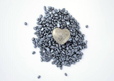 Fool's gold heart on hematite pebbles - Heart of stone Stock Photo - 10933683