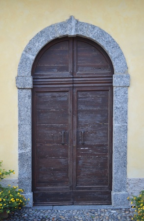 open gate: Old wood and stone external door or gate