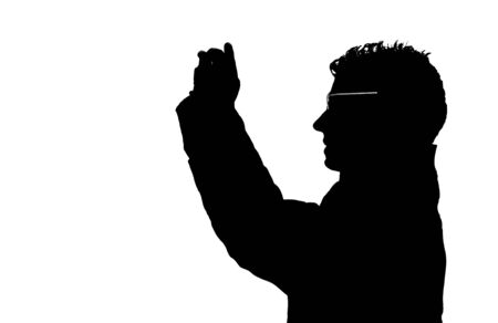 Silhouette of a guy taking pictures with a cell (mobile) phone or point and shoot (compact) camera photo