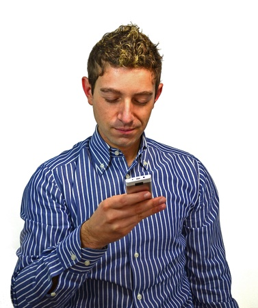 Good looking guy sending or reading text message on his mobile phone photo