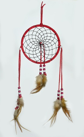 Simple, red, native american dreamcatcher isolated on white photo