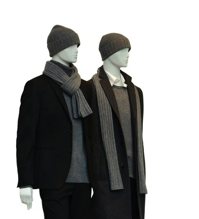 window display: 2 male mannequins with winter clothes isolated on white