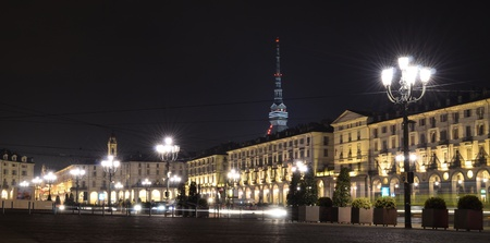 squares: Piazza Vittorio in Turin, Italy, at night with Mole in the back