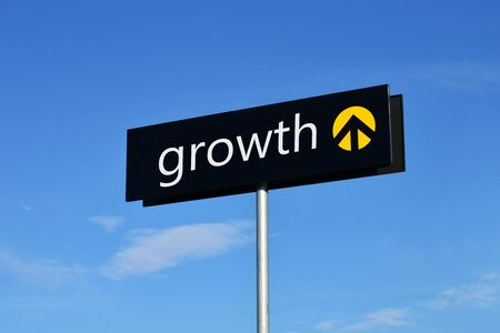 Street sign with upward arrow reading growth  photo