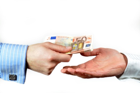 Male hand paying 50 euros to someone else, isolated on white Stock Photo - 11689111