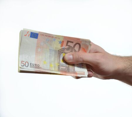 Hand giving, handing over or donating stack of 50 euro bills photo