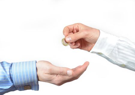 donates: Hand gives or donates a 1 euro coin to another hand. Isolated on white
