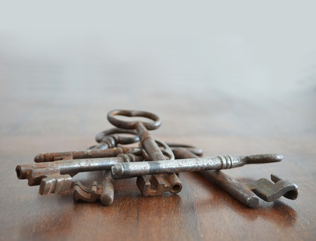 Bunch of old rusted keys on wood surface Stock Photo - 11986364