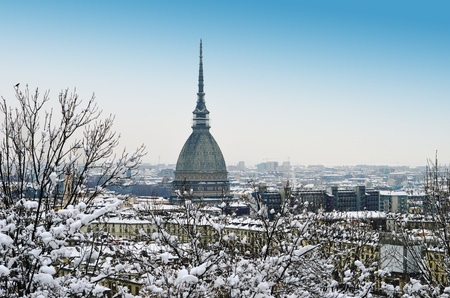 Turin, Italy, in winter  Snow covered roofs and Mole Antonelliana