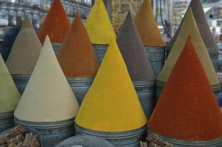 Colorful spice cones in traditional shop or market photo