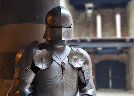 shiny suit: Man in a medieval armor  Stock Photo