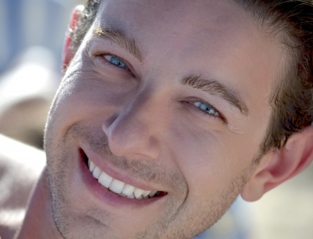 Head shot of blue eyed attractive male model smiling Stock Photo - 15036488