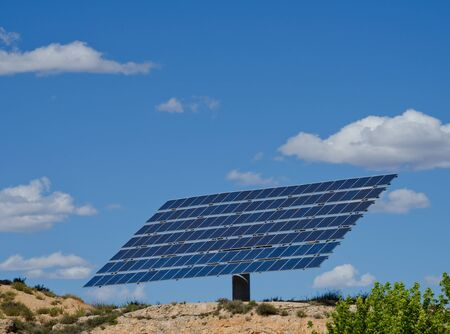 Large photovoltaic solar panel against blue sky photo
