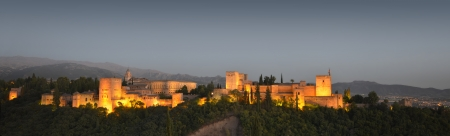 The Alhambra, in Granada, Spain at twilight Evening panorama