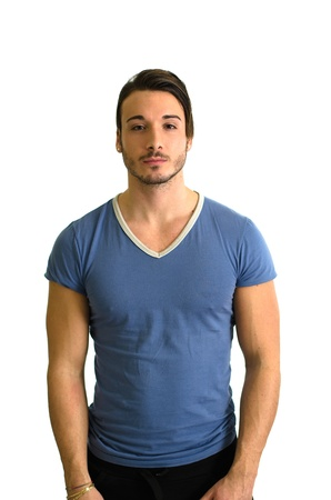Attractive, muscular guy standing and looking in camera, isolated
