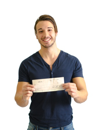 Happy, smiling young man with check (cheque) in hands, looking at camera photo