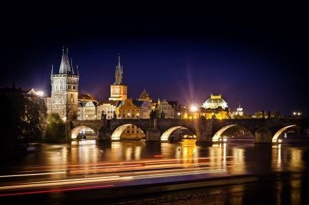 Prague, Czech Republic. Night photo of Charles Bridge and historical buildings photo