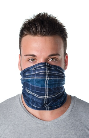 Handsome young man with mask over face as a robber or bandit, isolated on white photo