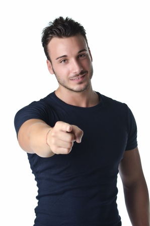 Smiling young man gesturing with his hand, pointing finger at you, isolated on white photo
